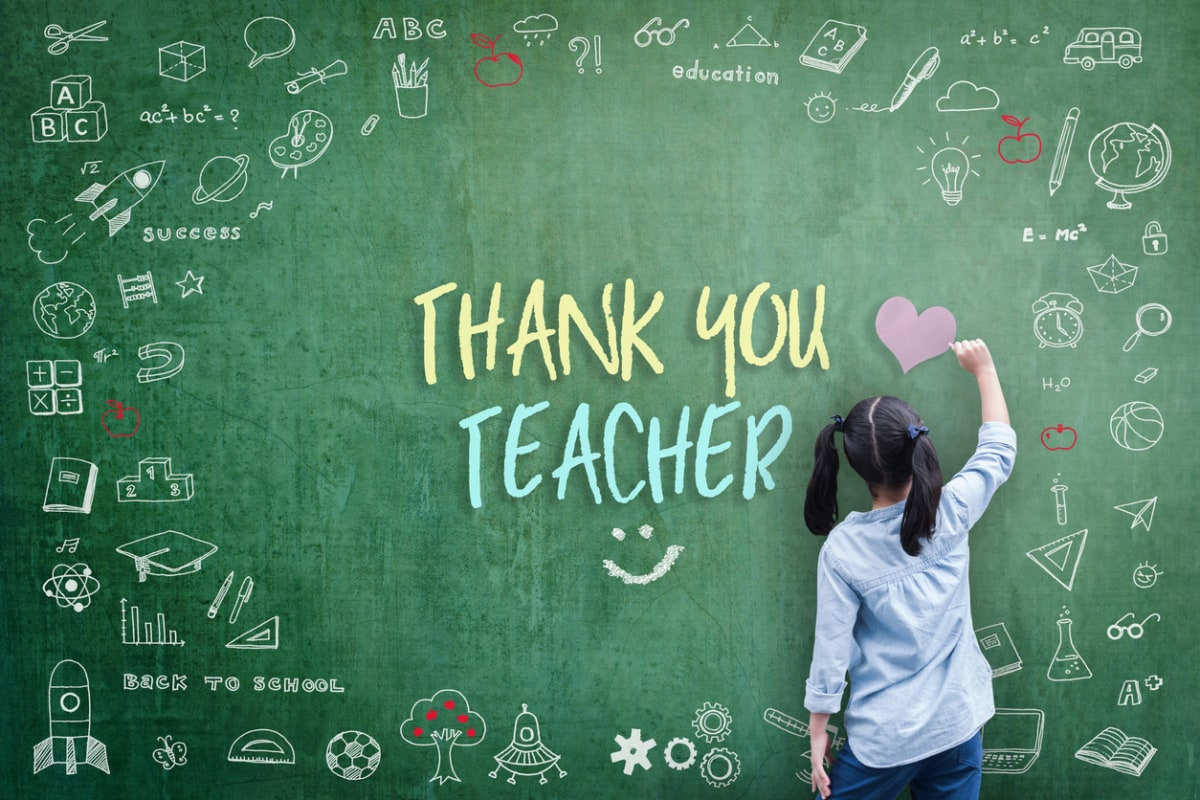 A girl at an oversized, stylised blackboard, her back to the camera, writing 'Thank you teacher'.