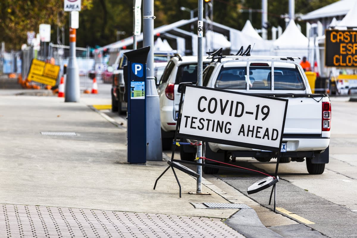 """Picture of road with """"COVID testing ahead"""" sign"""