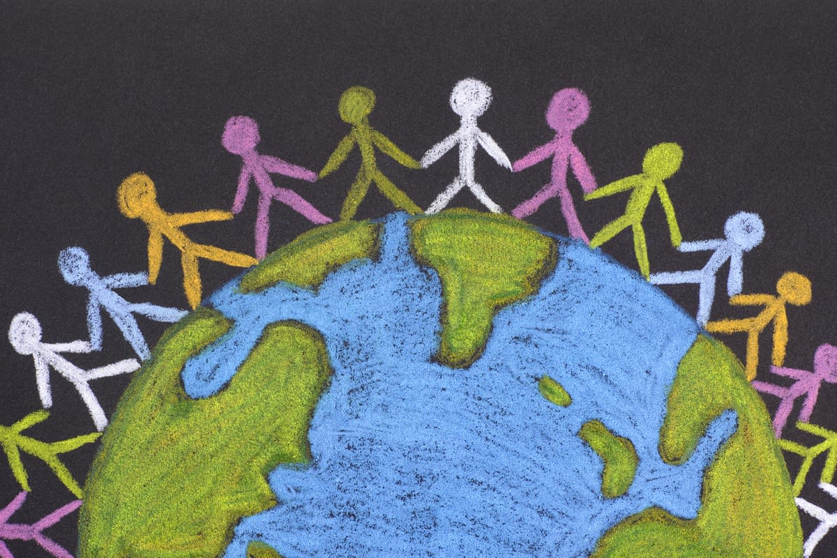 A chalk drawing of Earth, encircled by multi-coloured stick figures holding hands