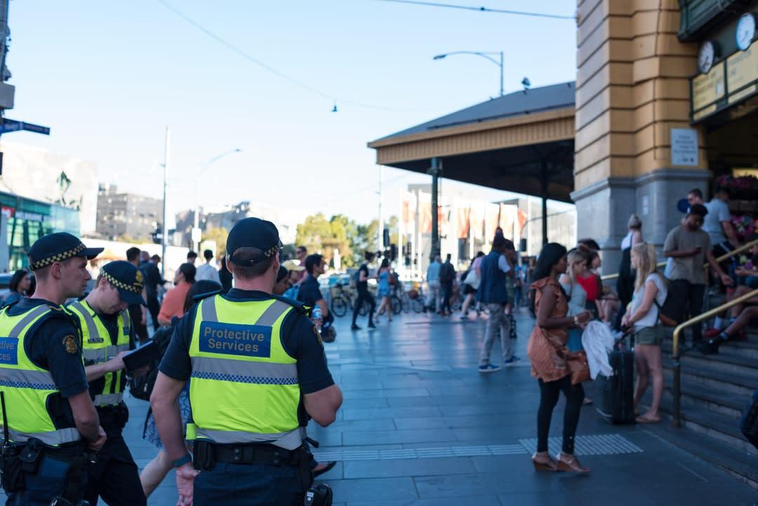 Protective Service Officers patrol Flinders Street, Melbourne.