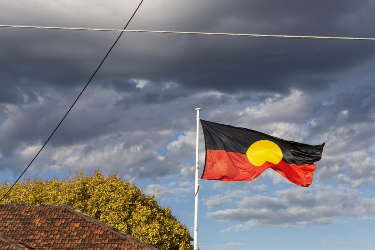 Aboriginal flag with a dark sky backdrop