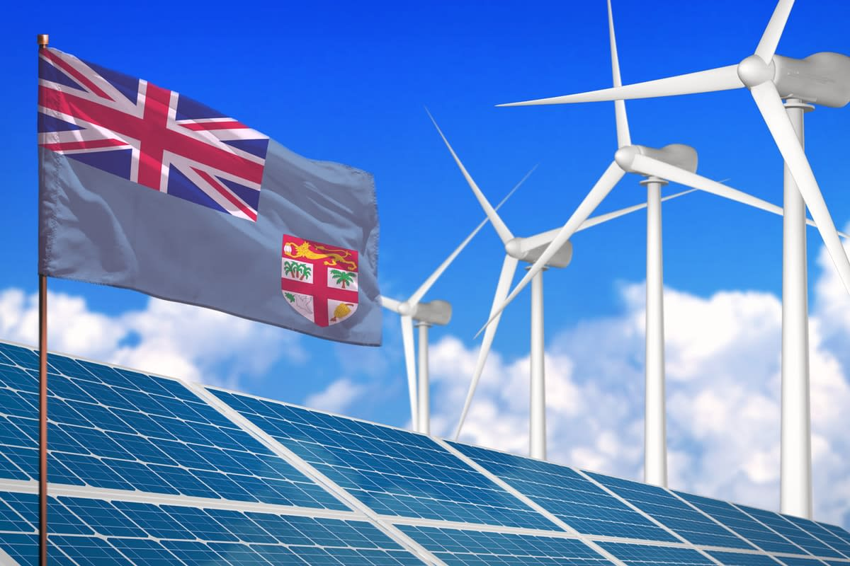 Composite image of a Fiji flag with solar panels and wind turbines.