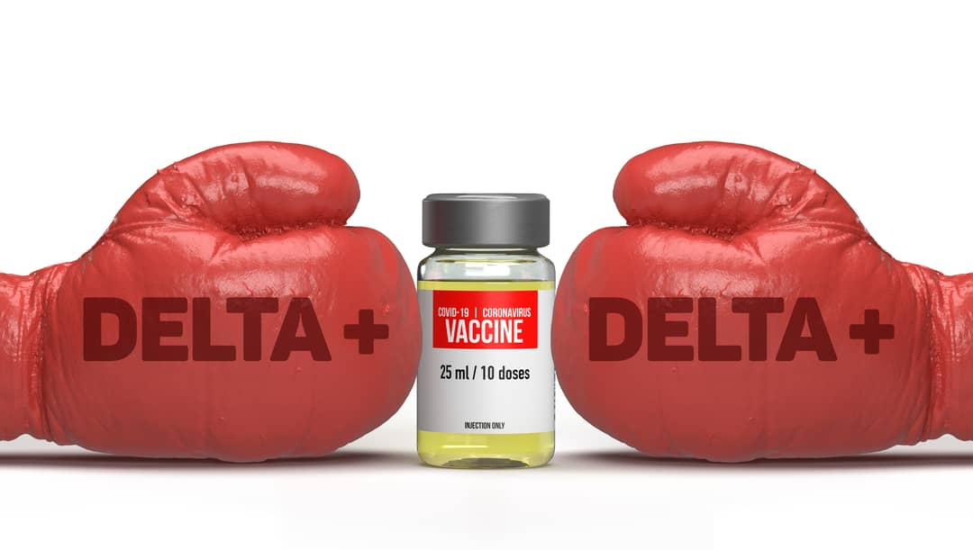 Delta plus virus infected boxing gloves are hitting a coronavirus vaccine filled glass bottle