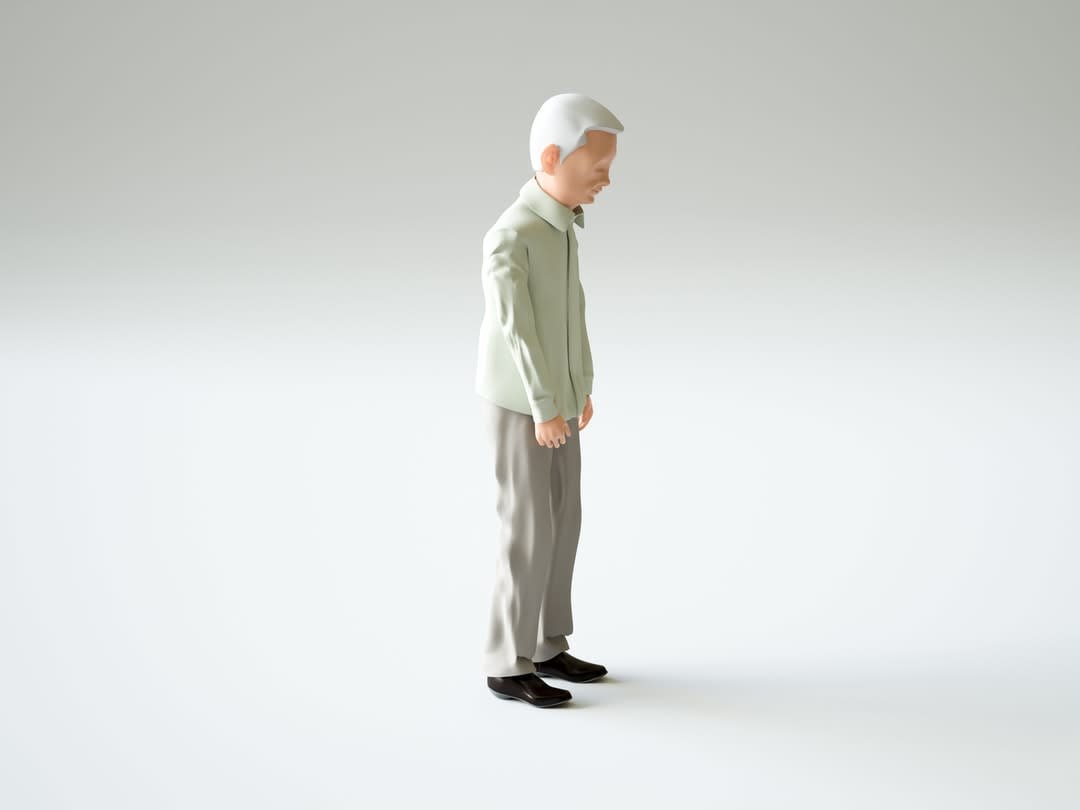 Figurine of an old man standing alone.