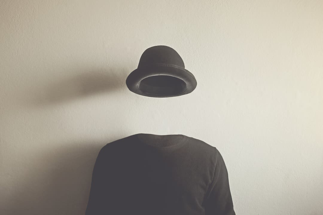 Invisible man wearing black bowler hat.