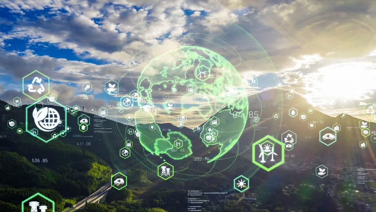 Green hilly landscape overlaid with a digital representation of Earth, with sustainable development icon