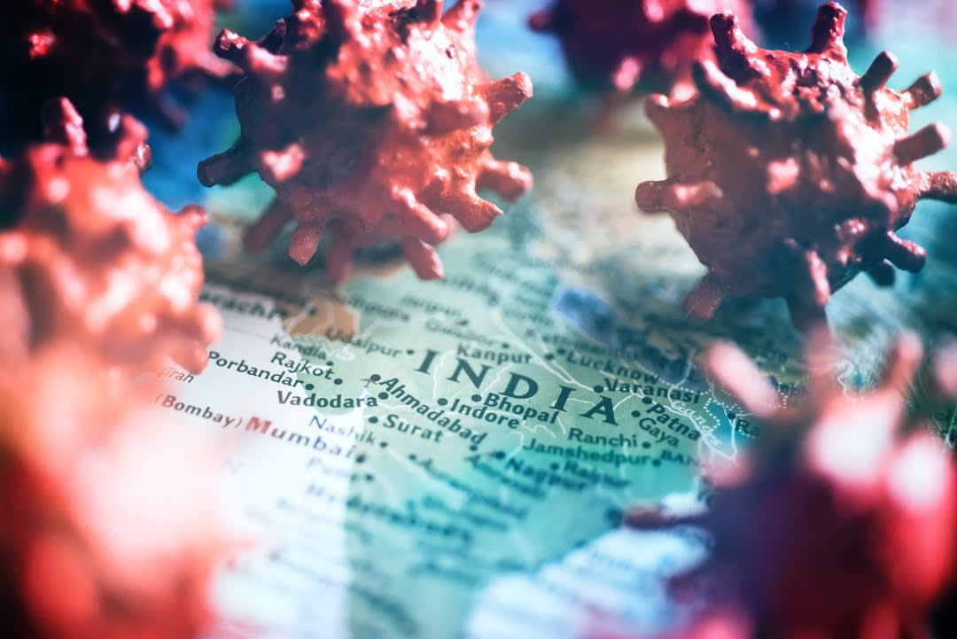 Map of India and coronavirus concept.