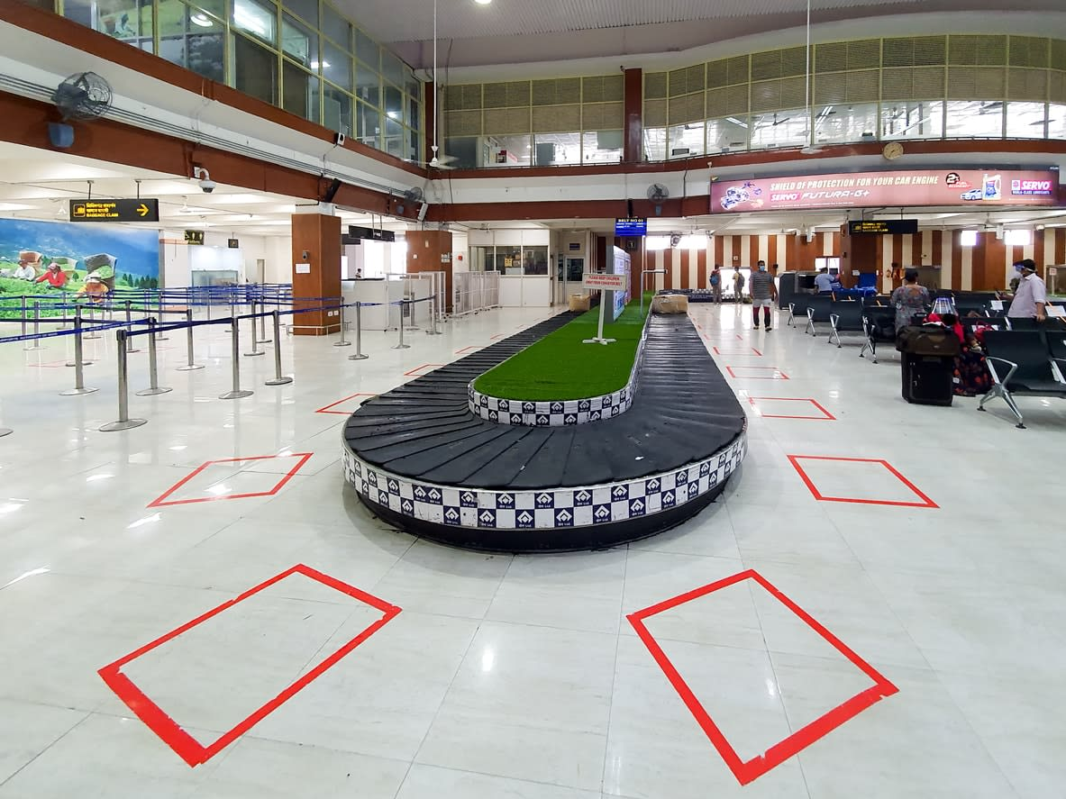 A baggage carousel in an all-but-empty Indian airport terminal