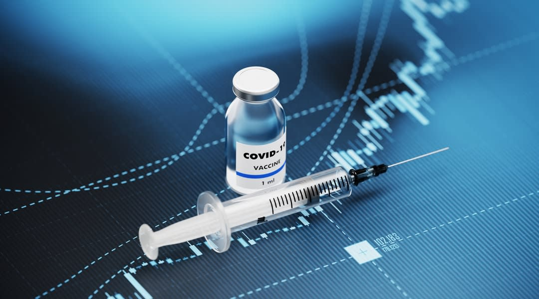 A vial of COVID-19 vaccine and a syringe