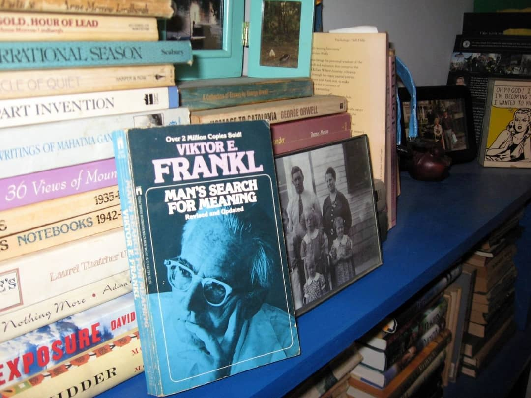 A stack of paperback books with Viktor Frankl's 'Man's Search For Meaning' in the foreground