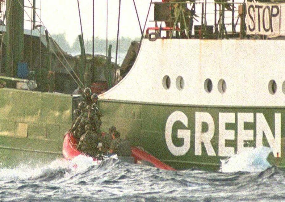 French commandos board the Greenpeace ship Rainbow Warrior off Mururoa atoll in 1985. Photo: Marcel Mochet / Getty Images