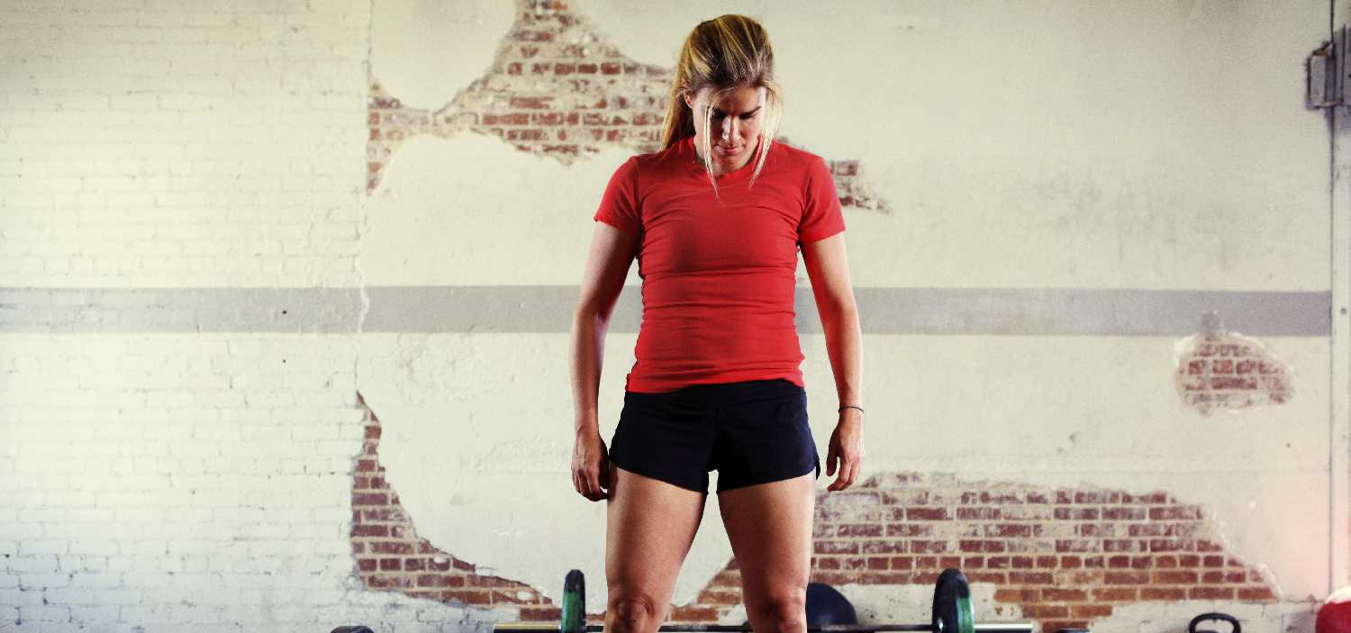 Athlete Contemplates Barbell