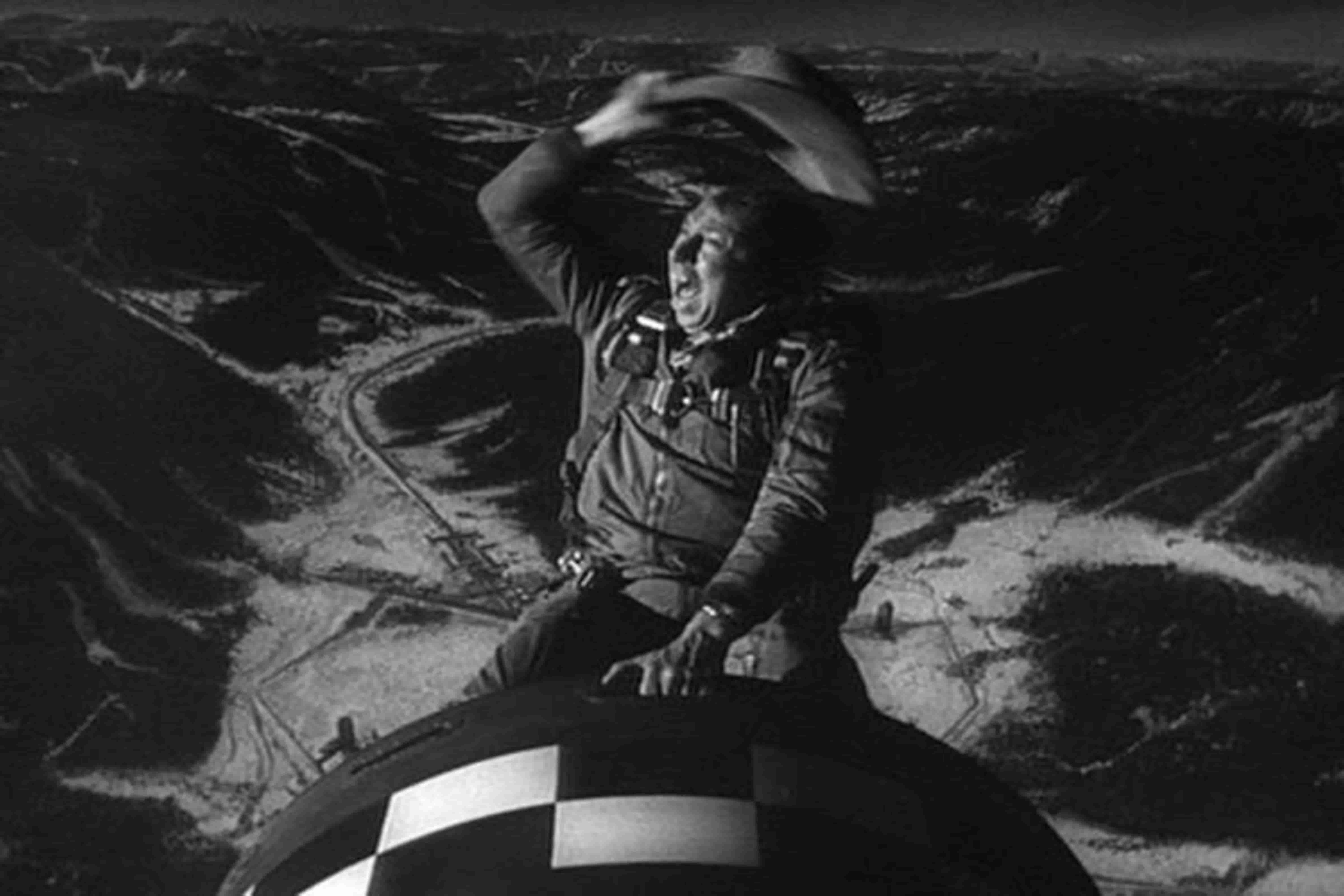 Slim Pickens in Dr. Strangelove riding the atom bomb out of the plane like a rodeo cowboy