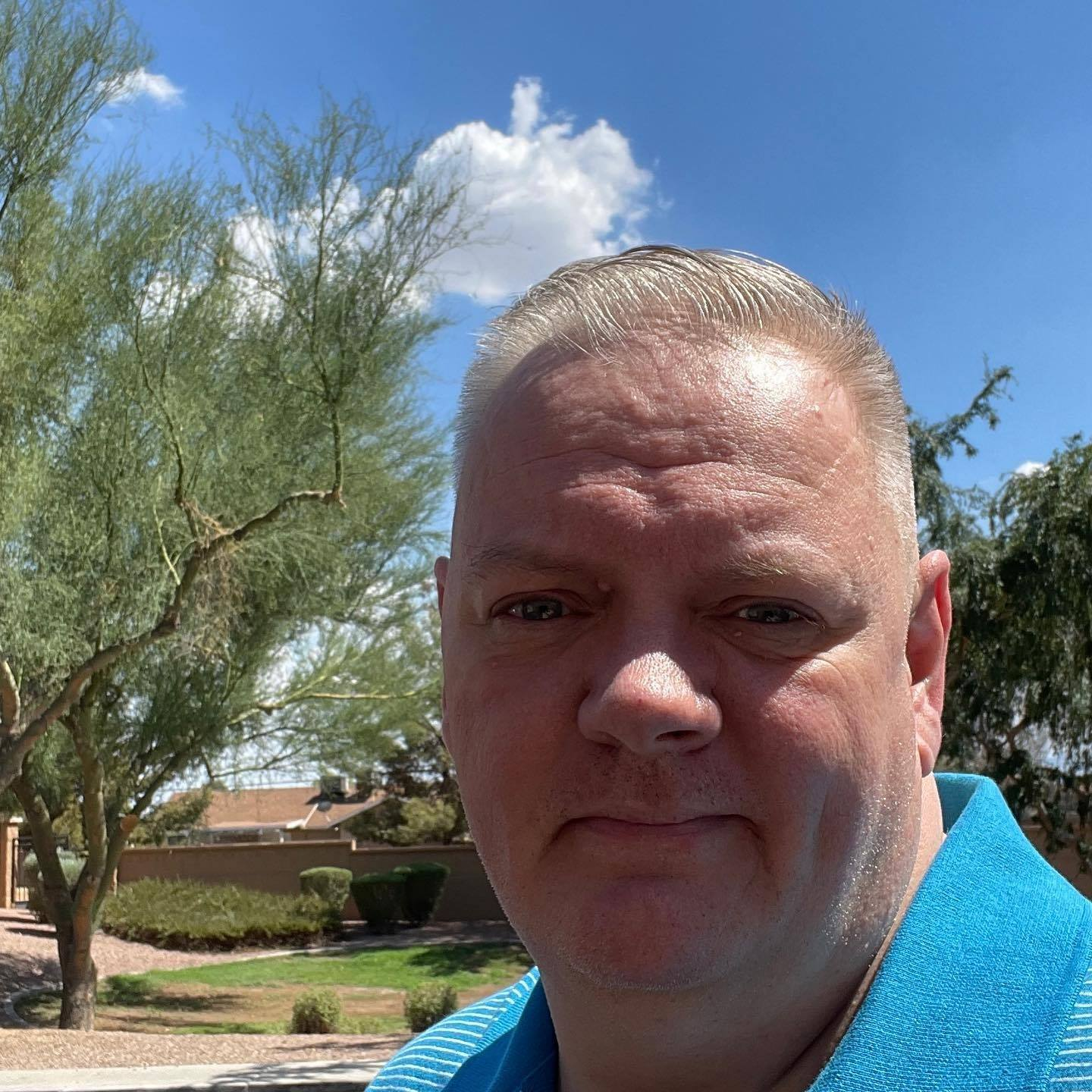 Todd standing outside in Arizona ona sunny day.