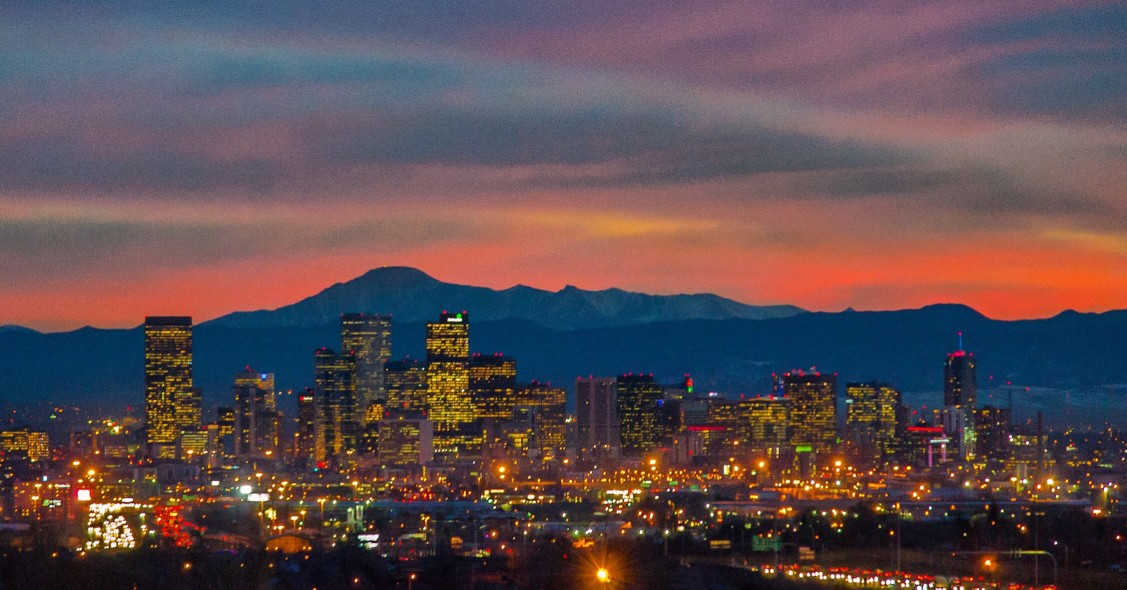 downtown denver with pikes peak in the background while the sun sets t20 nemg9g nl63nj