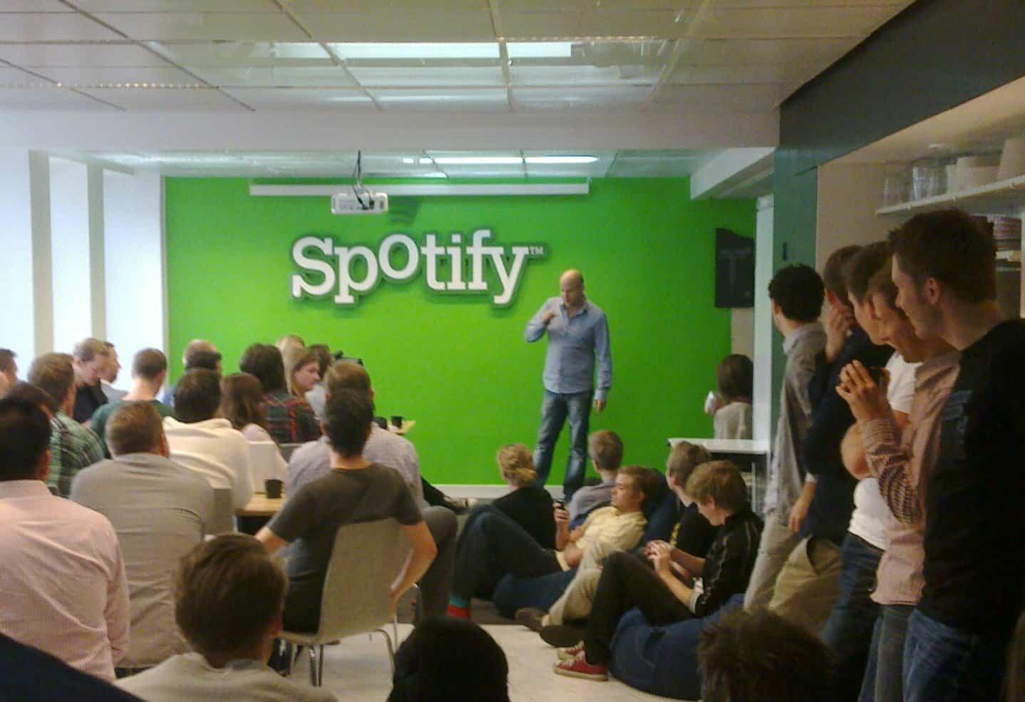 Spotify going public through a direct public offering https://commons.wikimedia.org/wiki/File:Daniel_Ek_addressing_Spotify_staff.jpg