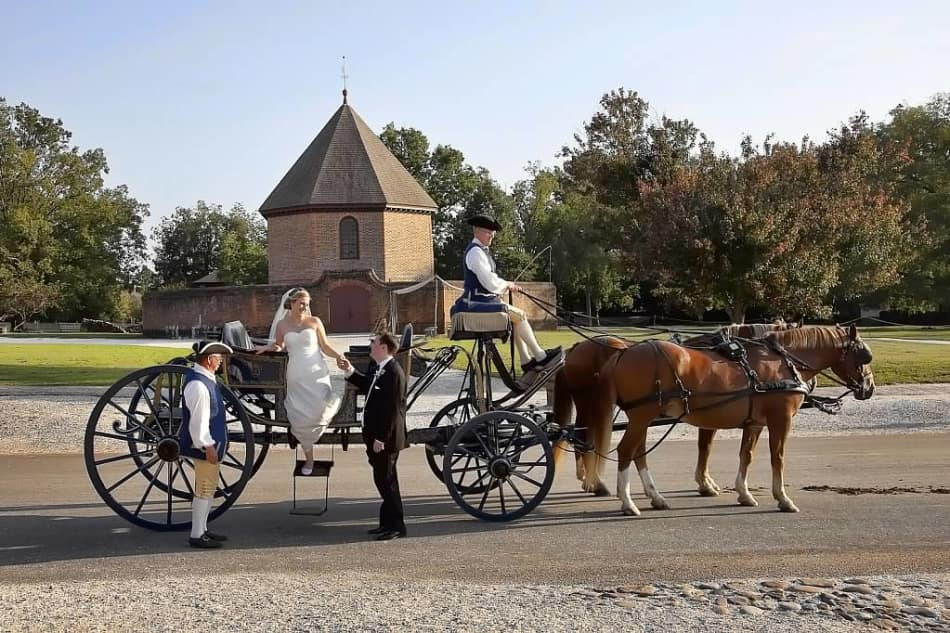 A wedding carriage in front of the Magazine