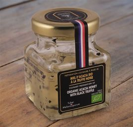 Organic acacia honey with black truffle - A French and organic acacia honey whose delicately floral notes are enhanced by slivers of black truffle. Ideal for deglazing a meat after cooking or with cheese.