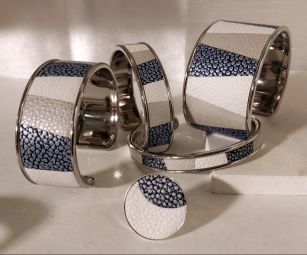 """Luxury """"leather marquetry"""" collection - Marquetry collection: The traditional technique for making leather marquetry is to delicately trace and cut the pieces of leather using special tools. The next difficulty is to assemble, between them, small pieces of leather, to dress the metal support. The stages of production are long and very meticulous, each bracelet being unique, there are always variations from one model to another. The color associations are infinite and can be personalized on request."""