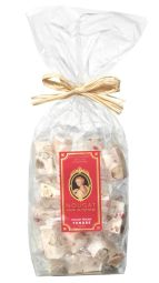 Nougat with almonds and red pralines - The alliance of 2 French gastronomies, between Montélimar and Lyon. When the Montélimar nougat is adorned with nuggets of red pralines from Lyon. A delight in the mouth!