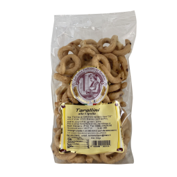 Tarallini with Onion - Genuine artisanal Pugliese tarallini made in San Severo (Gargano-Puglia), the tarallino is ideal for aperitifs.  A salty and crunchy biscuit with an intense taste and a real consistency. Discover our onion-flavoured tarallini: a marvellous treat for an aperitif or a snack.  Weight: 300g