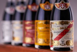 Balsamic Vinegars - Historical Collection - Giusti is the oldest producer of Balsamic Vinegar of Modena, founded in 1605 and today managed by the 17th generation. The family owns 600 wooden barrels from the 17th, 18th and 19th centuries: a real treasures that give unique aromas to our vinegars. Giusti balsamic vinegars have collected many recognitions since the company's foundation through to today. The most meaningful awards were obtained during the Belle-Epoque, when the Giusti family presented their balsamic vinegars at national and international exhibitions. The 14 Gold Medals that characterize the famous Giusti label, designed in the early 1900s, date back to this era. In addition to these medals, there is also the Royal Seal of Approval, granted from the King of Italy in 1929. The history of Giusti and the secrets of the traditional production of Balsamic Vinegar of Modena can be  experienced in our Giusti Museum in Modena.