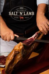 Lamb Ham - SALT'N LAMB presents the leg of lamb in its purest tradition -salt(ing), dry-cured in a natural and artisanal way from the region of Teruel in Spain. Our lamb ham is the result of several years of research and work to achieve a truly qualitative and exclusive product, satisfying the curiosity and appetite of many gourmets looking for new and unique expériences. Originally from the provinces of Aragon and Castilla, the lambs used for our hams are raised by small local producers with the greatest care, out-doors and roaming free.   Thanks to a natural diet and regional climate, after salting and maturing, a completely exceptional meat is produced with an intense taste and a soft and oily texture. During the curing of our hams, lasting between 6 and 12 months, we carry out regular tests and checks on each piece to ensure all the aromas are released and the texture becomes increasingly tender. From the top of its steep rocky headland, at 1,300 meters above sea level, our dryer made with natural stones, in the village of Cantavieja, benefits from an exceptional and unique geographical position in the Province of Aragon. At this altitude, the medieval and authentic air that blows here is the unique setting for our meat refining activity. The nurturing of such delicate meat combined with the natural climate, the authentic drying and refining techniques plus the traditions and years of knowledge from our region make our lamb ham a truly unique product the world over!