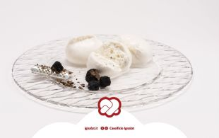Burrata cheese with black truffle - A luxury and elegant variant of the typical burrata, which releases a consistent black italian truffle taste to enrich the tasty and creamy filling of the burrata and give it a strong and pleasant flavour. Burrata cheese with black truffle can be matched with extra virgin olive oil, enriched with grated truffle or with eggs.