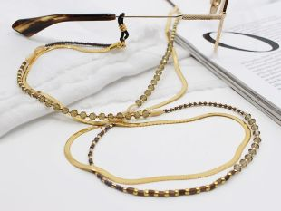 Emma-Jane - Double Sunglass chain - Take your look to the next level with a double chain. The timeless, golden glasses cord Emma pairs perfectly with beaded chain Jane. Also available separately!  ☆ Length: 72 cm ☆ Light weighted ☆ Rubbers fit any size frames ☆ Free speedy shipping  The chain is made of stainless steel with gold plating, plus a protective coating so that it doesn't lose its colour.