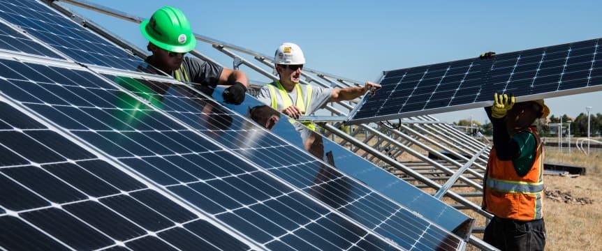 alt-Construction workers installing panels