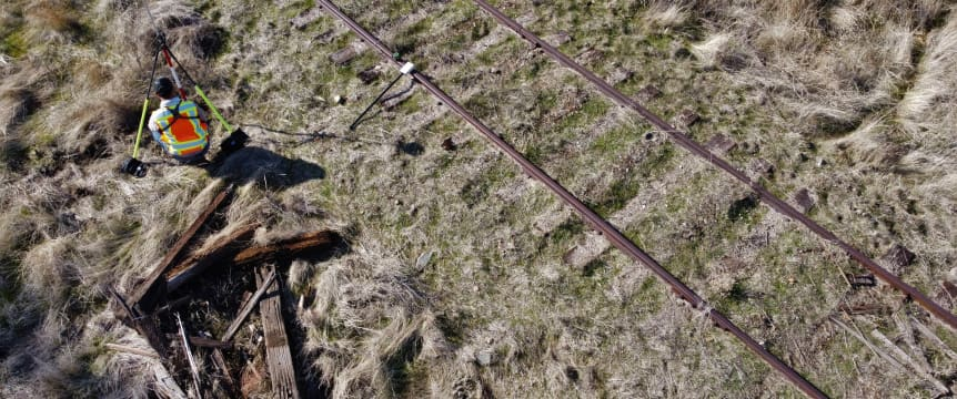 alt-Surveyor undertaking work in field