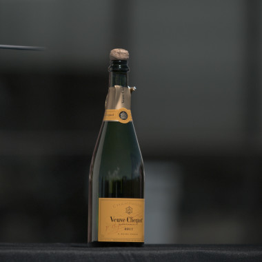 Cam Hanes Attempts to Pop Open a Bottle of Champagne With a Cork