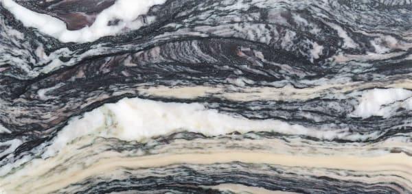 CipollinoEin expressiver Marmor aus den  westitalienischen Alpen, in dem feine Glimmerlagen einen geradezu  magischen Schimmer erzeugen.