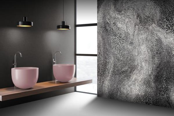 """Das Badezimmer ist nicht mehr nur Funktionsraum. Hier starten und beenden wir den Tag und wollen uns wohlfühlen. Von Rebado gibt es mit """"Newnature"""" eine Kollektion für Wand und Boden, die die Natur ins Bad holt. Entworfen von der Ippolito Fleitz Group, wurden für die gedruckten Oberflächen dynamische Strukturen wie Vogelschwarm- und Magnetfeld-Ordnungen verfremdet, skaliert und gefärbt. Newnature ist als Wandsystem aus recycelbaren Zementfaserplatten (""""Aspero"""") und Polymerplatten (""""Perluno"""") erhältlich. Oder als Bodenplatten aus Zementfasern (""""Floor""""), die ebenfalls recyclebar sind."""