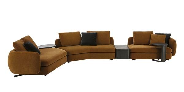 """Ein weiterer Entwurf des Franzosen ist das modulare Sofasystem """"Saint-Germain"""", dessen einladende, leicht angewinkelte Sitzflächen einen sanften Kontrast zu den runden Rückenlehnen bilden. Erhältlich mit Stoff- oder Lederbezug, der praktischerweise abziehbar ist."""