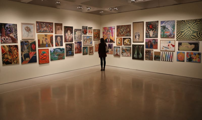 Jim Shaw's thrift store paintings collection. Installation view: Magnificent Obsessions. The Artist as Collector, Barbican Art Gallery.