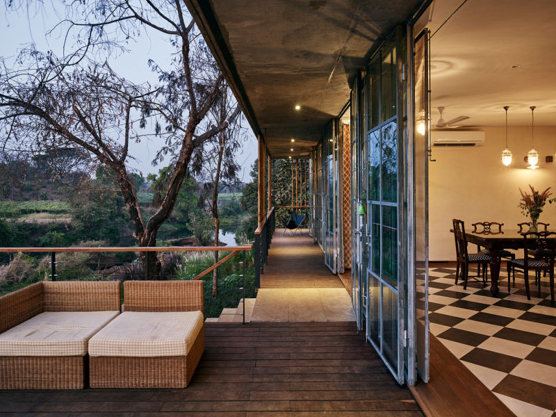 Architecture-BRIO_The-Riparian-House_Karjat-India__33-dining-room-and-verandah-during-sunset