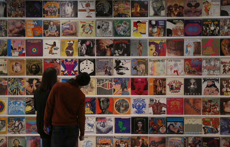 Dr Lakra's record covers collection. Installation view: Magnificent Obsessions. The Artist as Collector, Barbican-Art-Gallery.