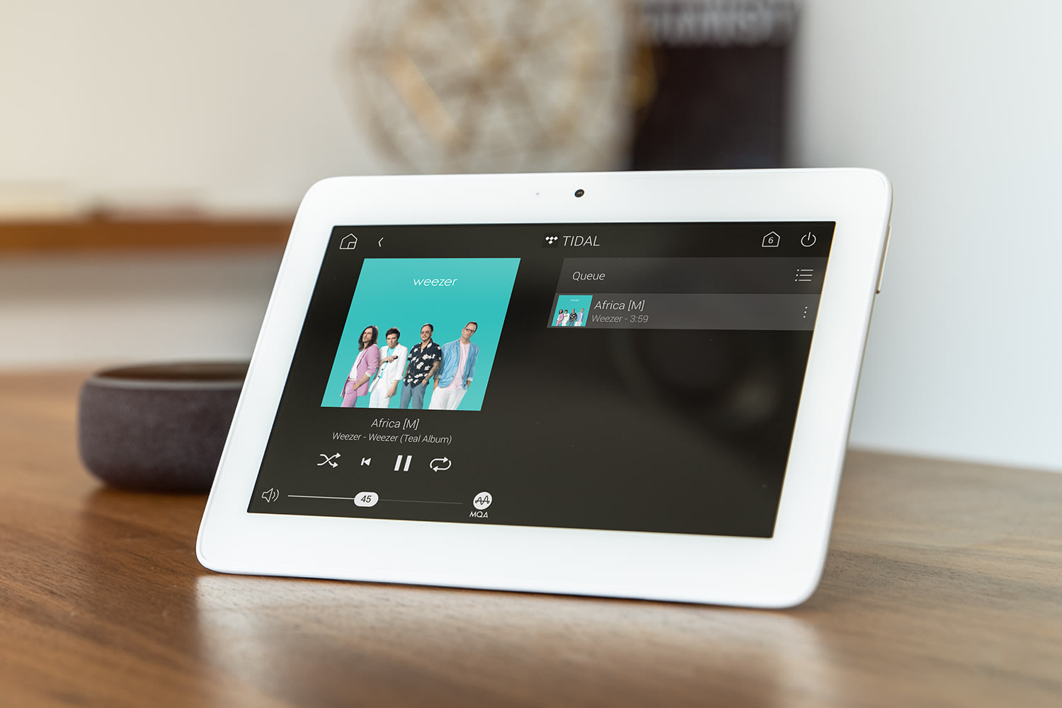 Tabletop touch screen displaying Tidal streaming music service