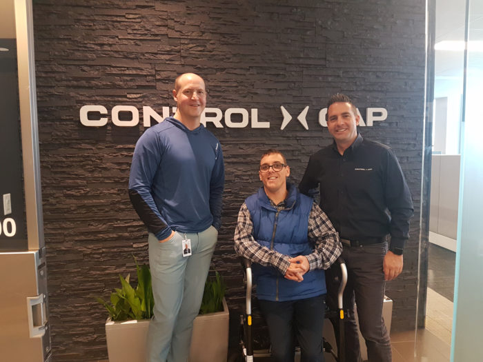 Control Gap Partners, Bruce Duff and Neal Christopher, with Easter Seals participant Casey MacKay at the Control Gap office in Mississauga, ON.