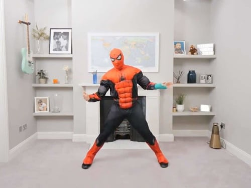Fitness instructor Joe Wicks teaching a class from his home, dressed as Spider-Man.