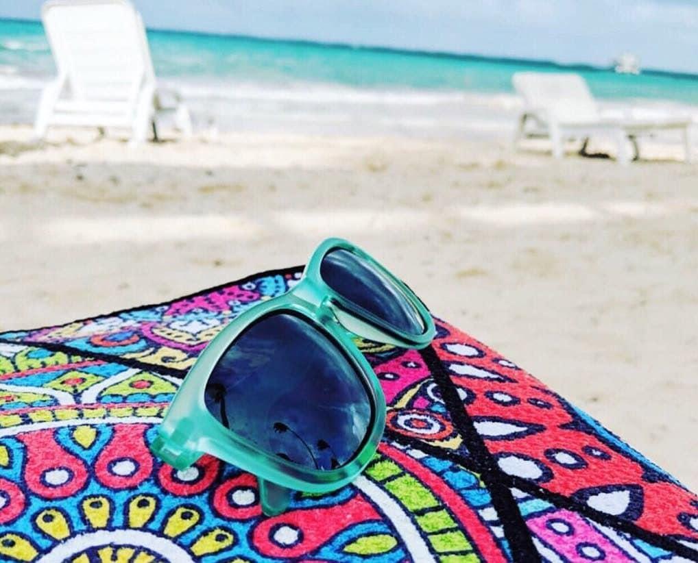 Photo of a Tesalate towel on a beach