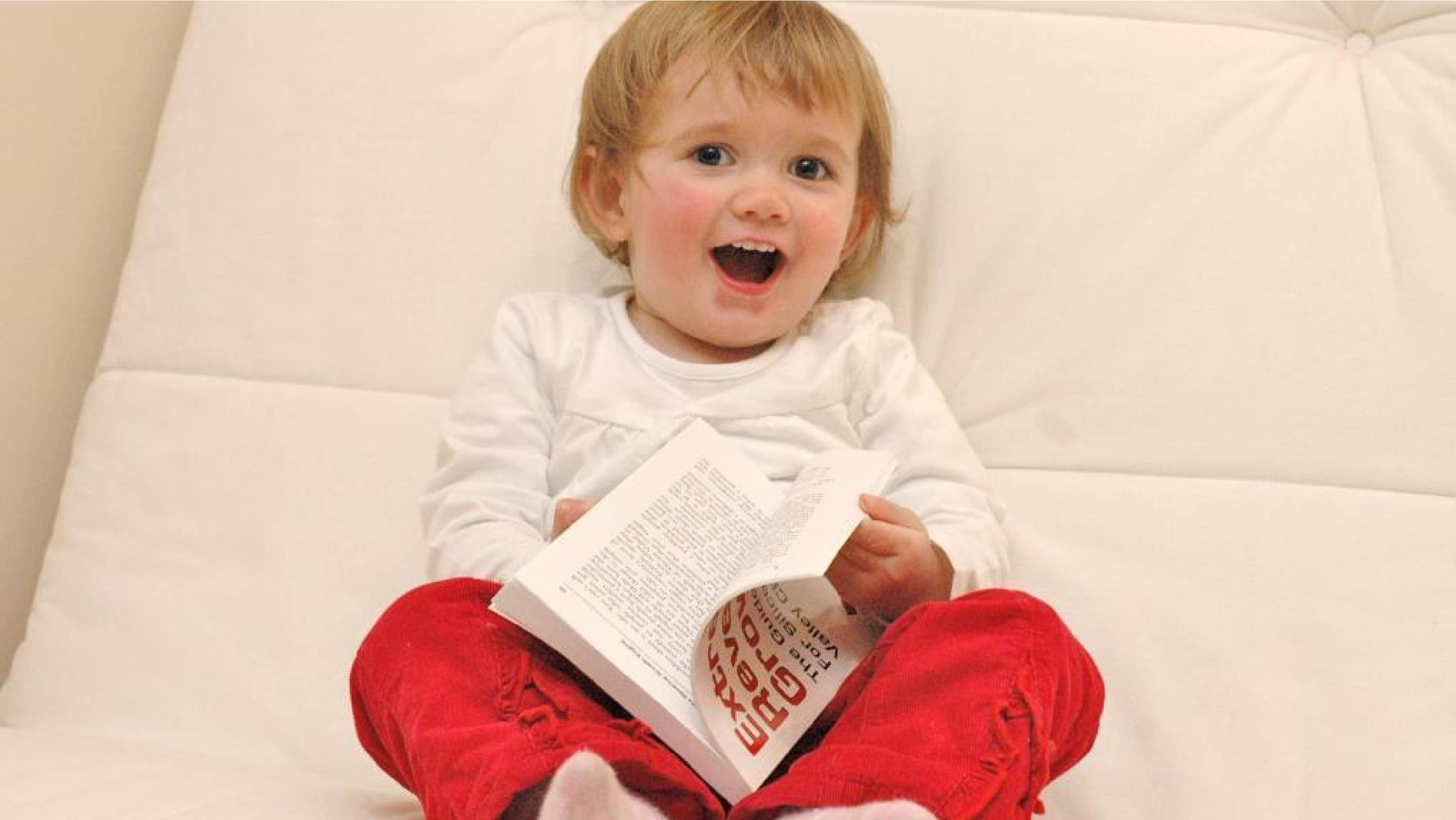 A photo of a child reading a book.