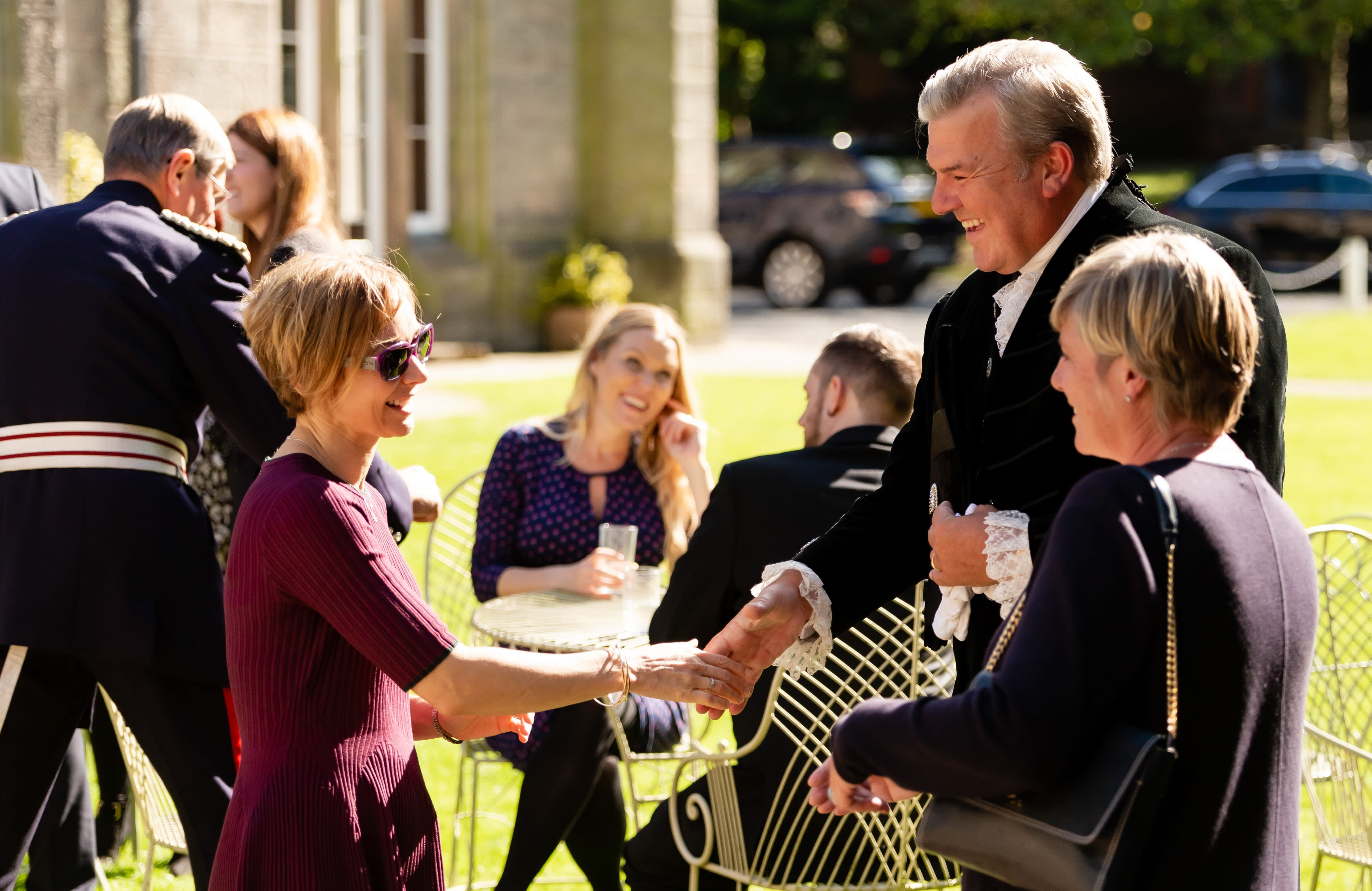 After the ceremony, everyone mingled in the gardens with tea and cake.