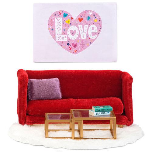 Indret stuen i dukkehuset med sofa og tilbehør