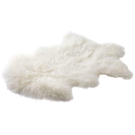 Silkeblødt og naturligt krøllet skind