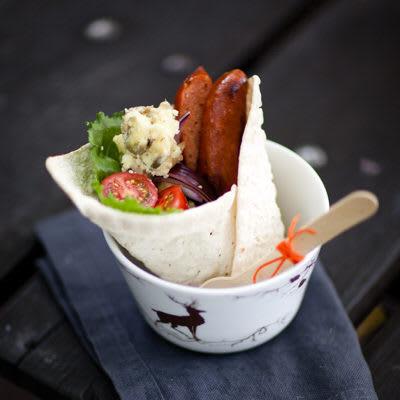 Bild på Korvrulle med potatis och inlagd gurka