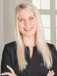 Irina Carp is a realtor for Premier Realty, a real estate company in Windermere.