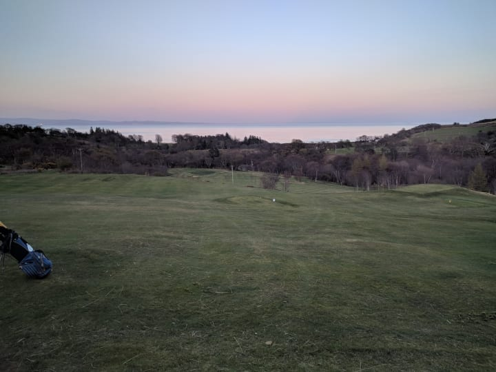 corrie golf course pink sky at night