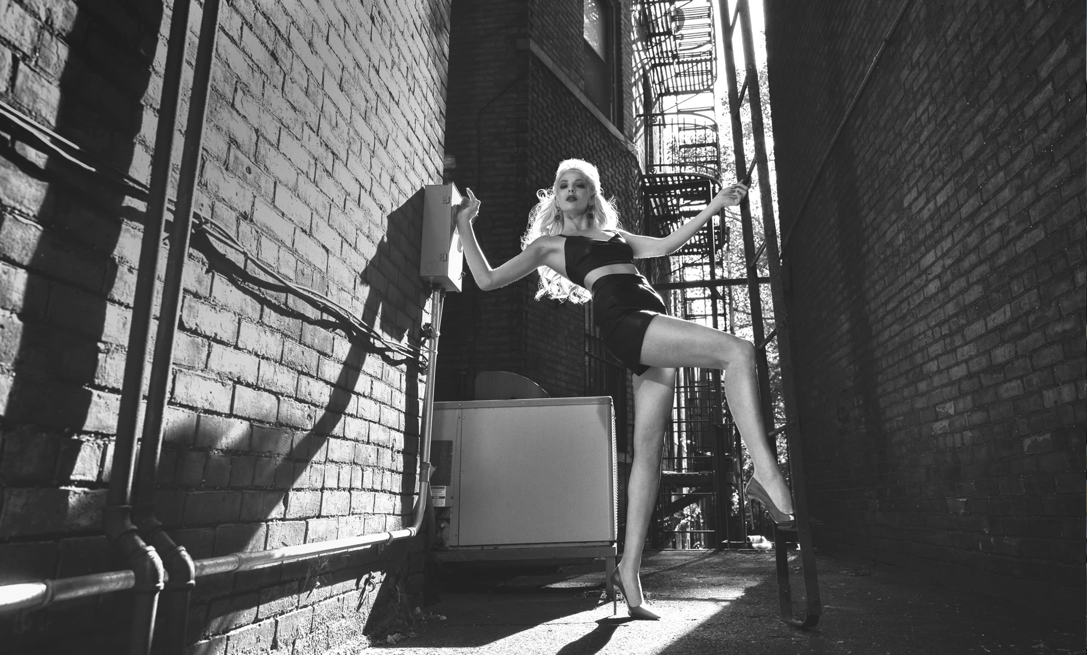 model posing in building alley